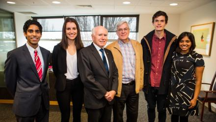 ANU economics students chat with former Prime Minister John Howard. Image: ANU.