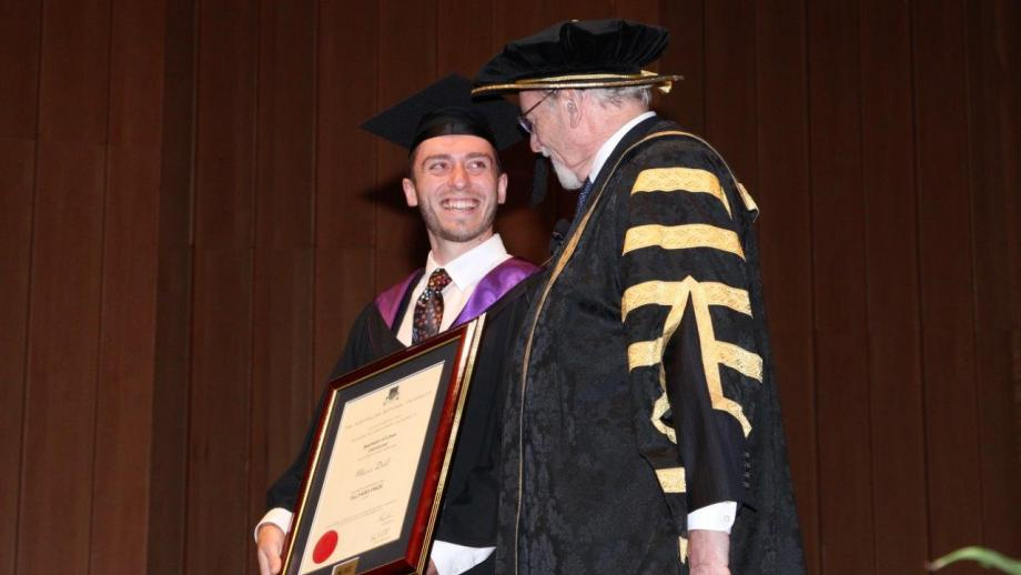 Marcus is pictured receiving the Tillyard Prize from Chancellor of the University, Professor the Hon Gareth Evans AC QC